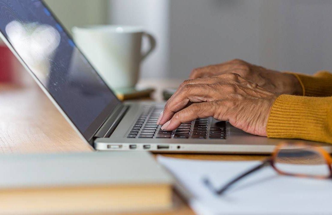 Close up of an older woman's hands typing on a keyboard. Letter of recommendation, recommendation letter, Next Avenue