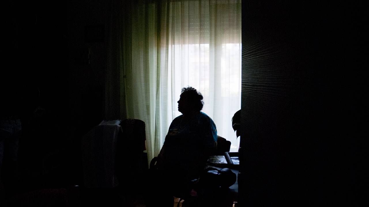 The silhouette of a person in front of a window. Loneliness, isolation, alone, Next Avenue