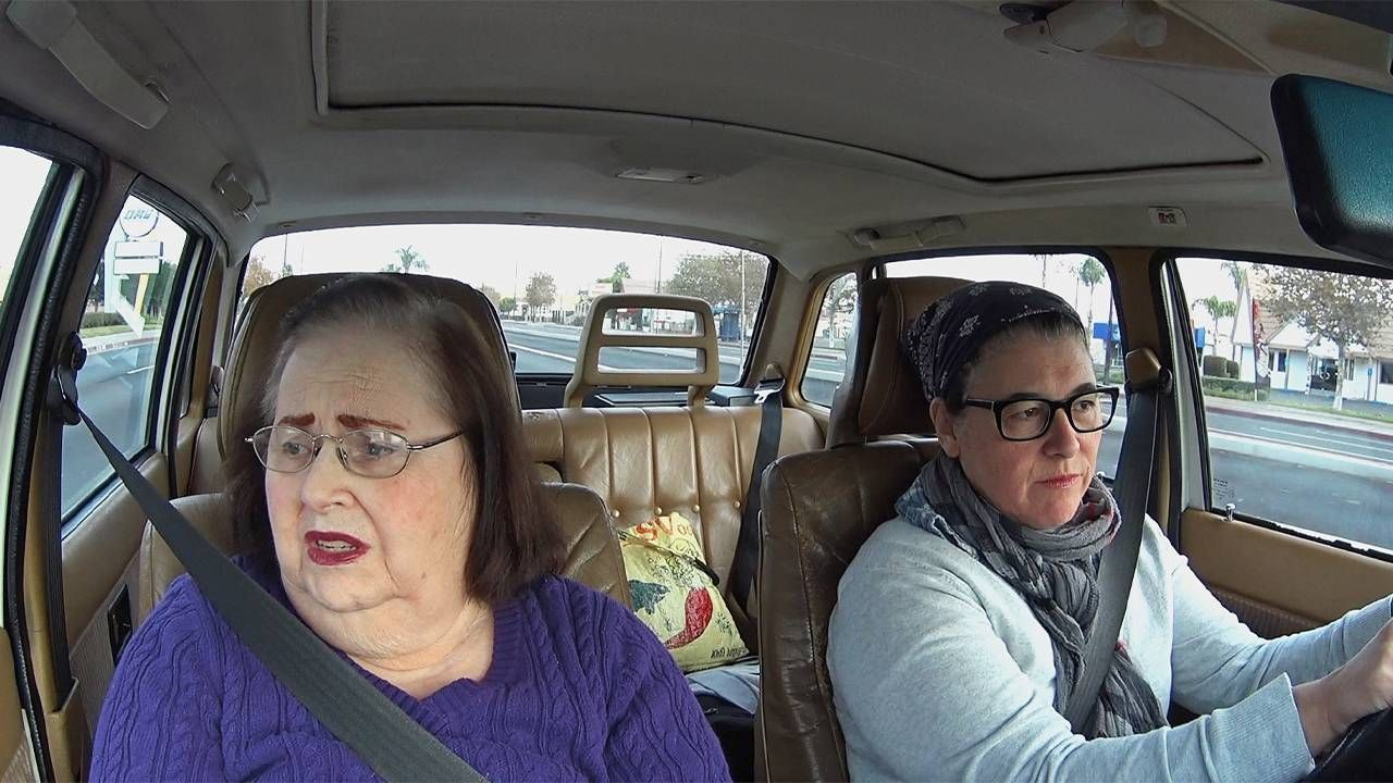 A caregiver and her mother driving in a car. Next Avenue, It's not a burden, caregiving
