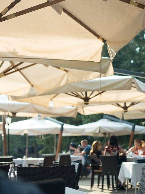 A patio covered with unbrellas. Sun exposure, Next Avenue