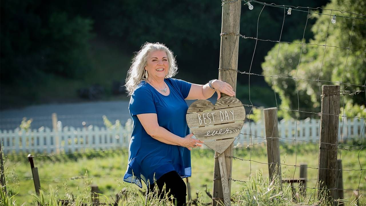 A woman standing outside near a fence. Entrepreneurs, small business, Next Avenue