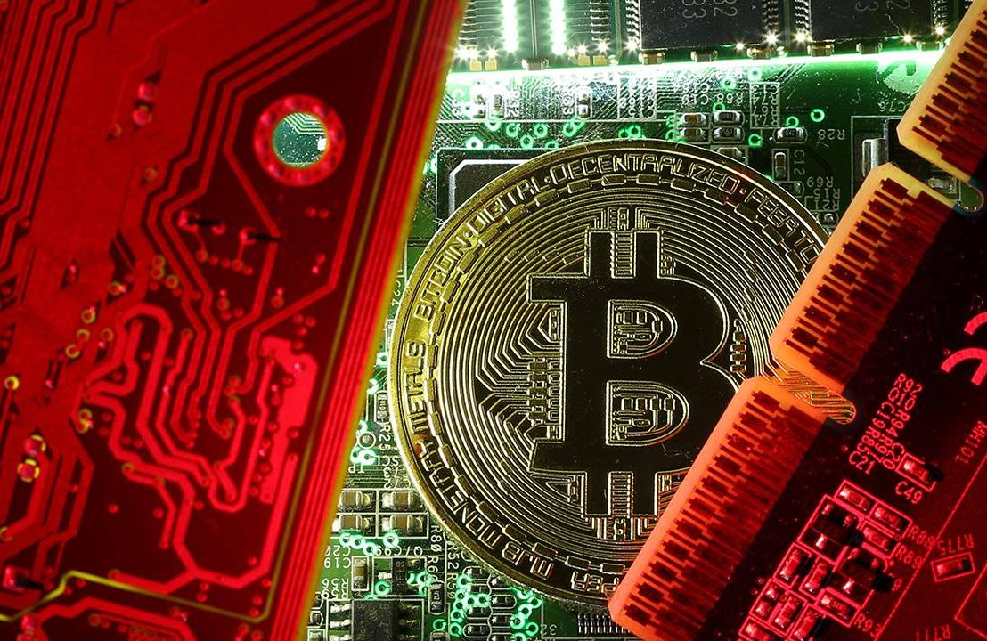 A Bitcoin coin next to computer microchips. Cryptocurrency, Bitcoin, Next Avenue