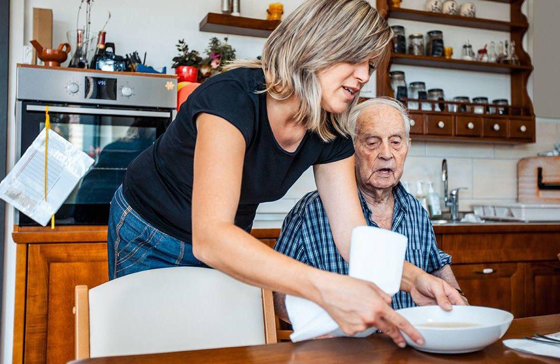 A caregiver taking care of a dementia patient. Alzheimer's, Next Avenue