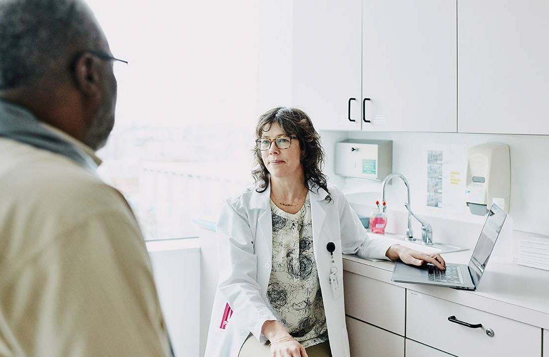 An older adult at the doctor's office. Dementia, Alzheimer's, cognitive screenings, Next Avenue