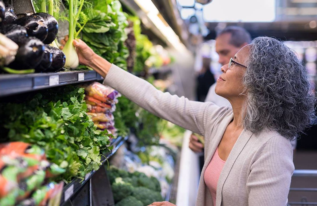 A woman shopping at the grocery store. Inflation, money, finances, Next Avenue