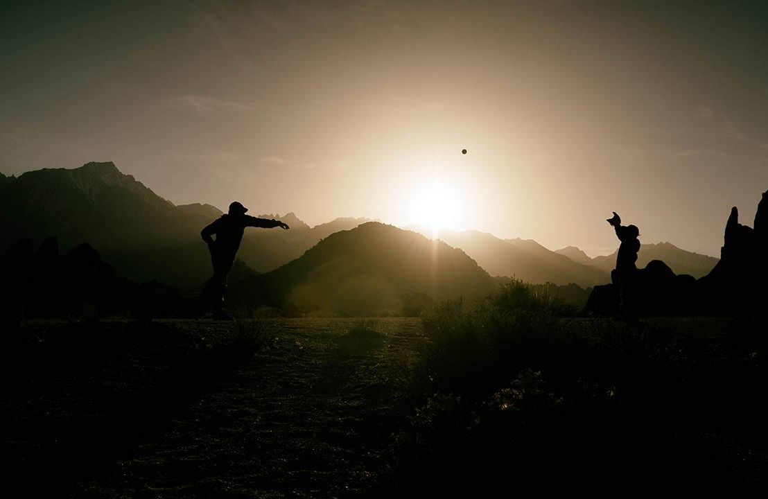 A silhouette of a father and son playing catch. Dad, father's day,Next Avenue