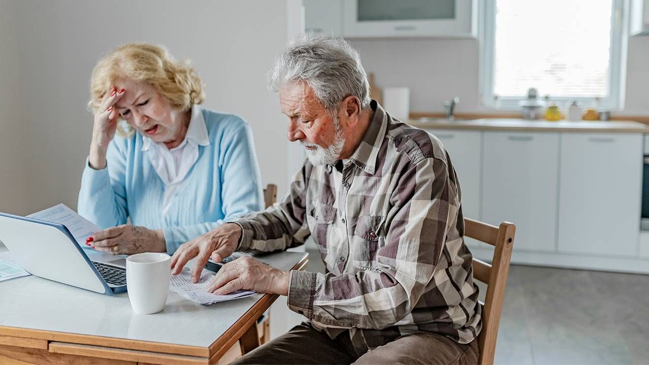 A couple sitting down looking at finances. Low income, the elder index,, Next Avenue