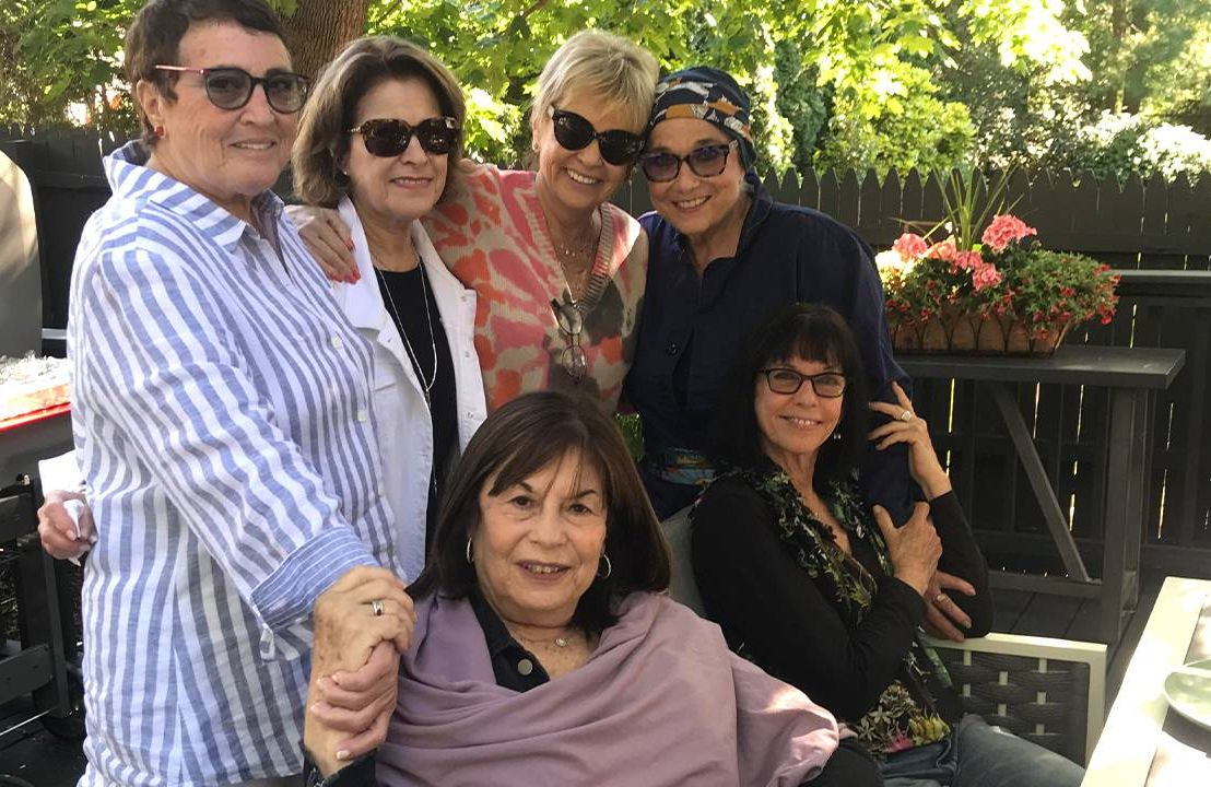 A group of friends together at an outdoor patio. Friends, friendship, Next Avenue