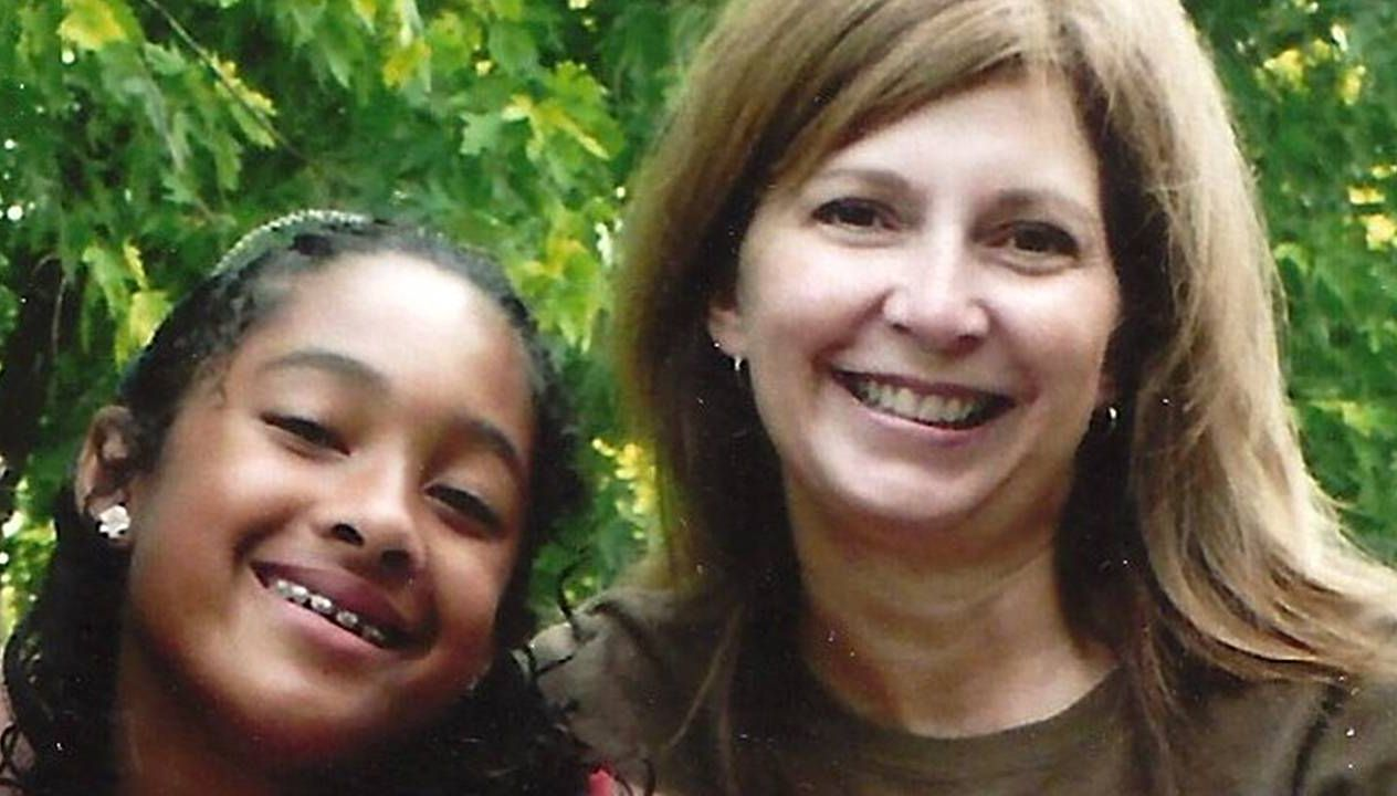 A grandmother and her granddaughter smiling. Racism, grandmother, Next Avenue