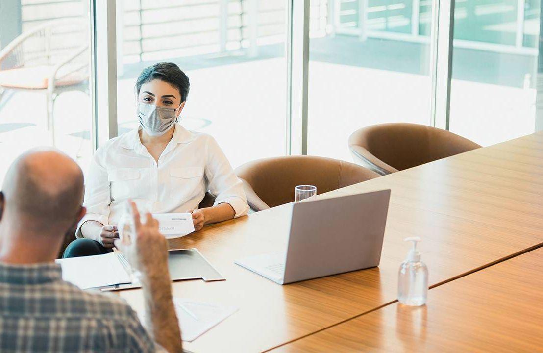 A woman interviewing a man for a job. Flexible work, interview, Next AVenue