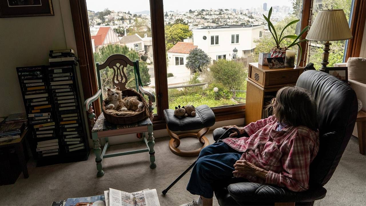 LGBTQ activist looking out the window of her home.  Lyon Martin house, lesbian activists,Phyllis Lyon, Del Martin, Next Avenue