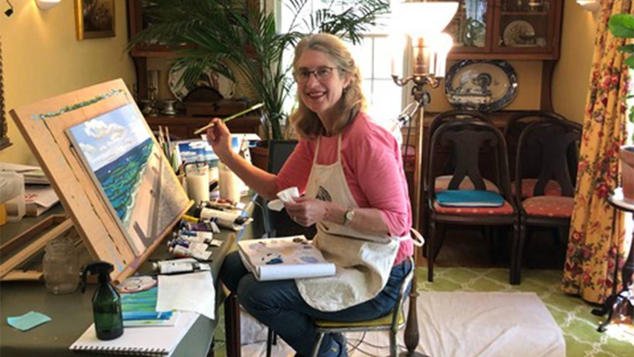 A woman painting in her dining room. Next Avenue, pivot, pandemic