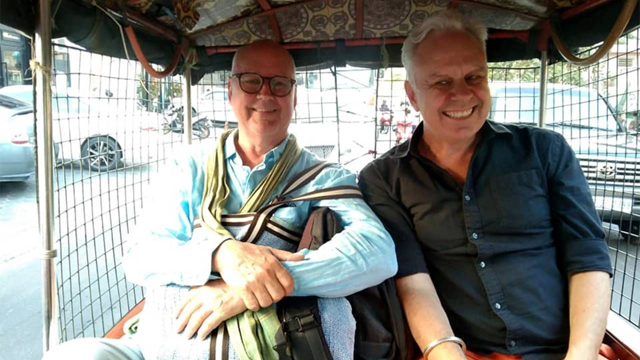 Two older men in a tuk-tuk taxi. Second-act business, Cambodia, Next Avenue