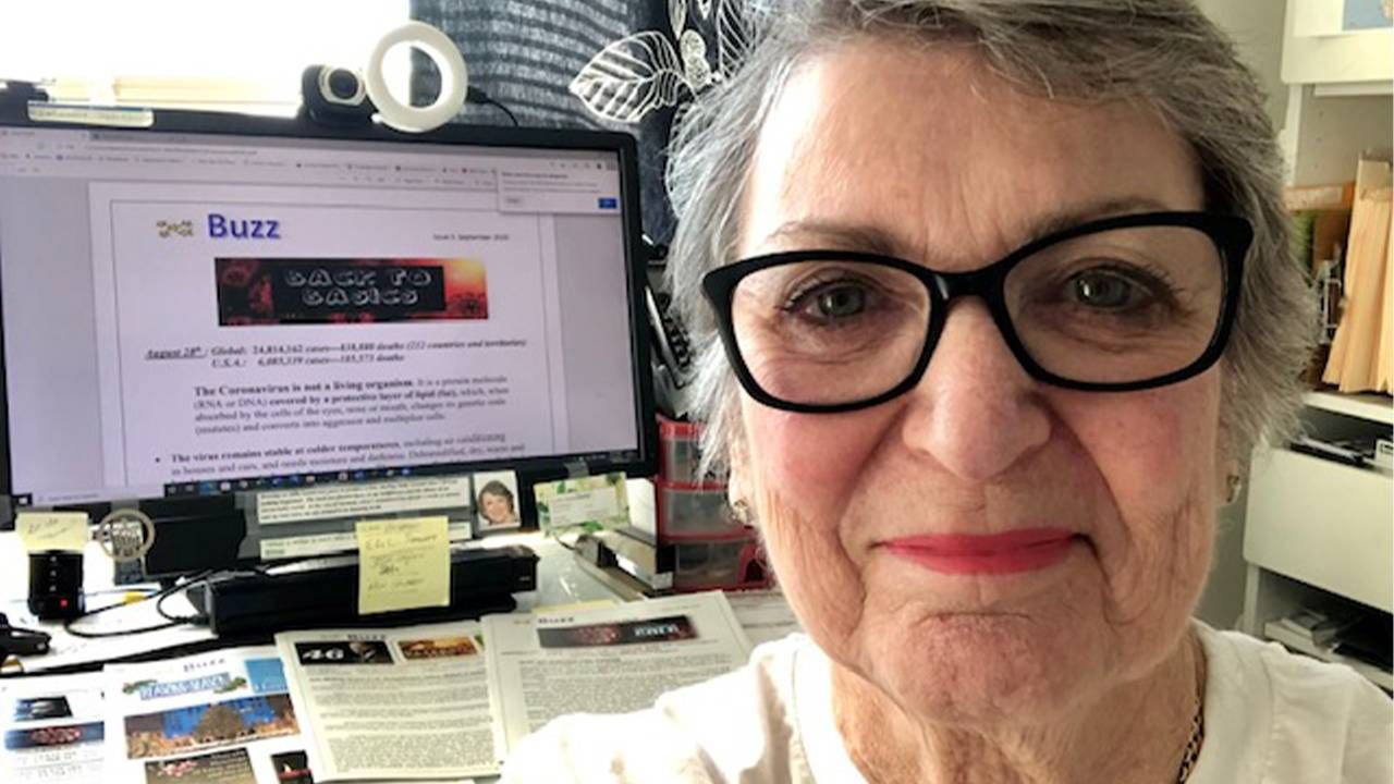 A woman sitting in front of a desk wearing glasses. The Buzz, COVID-19, Independent living, Next Avenue