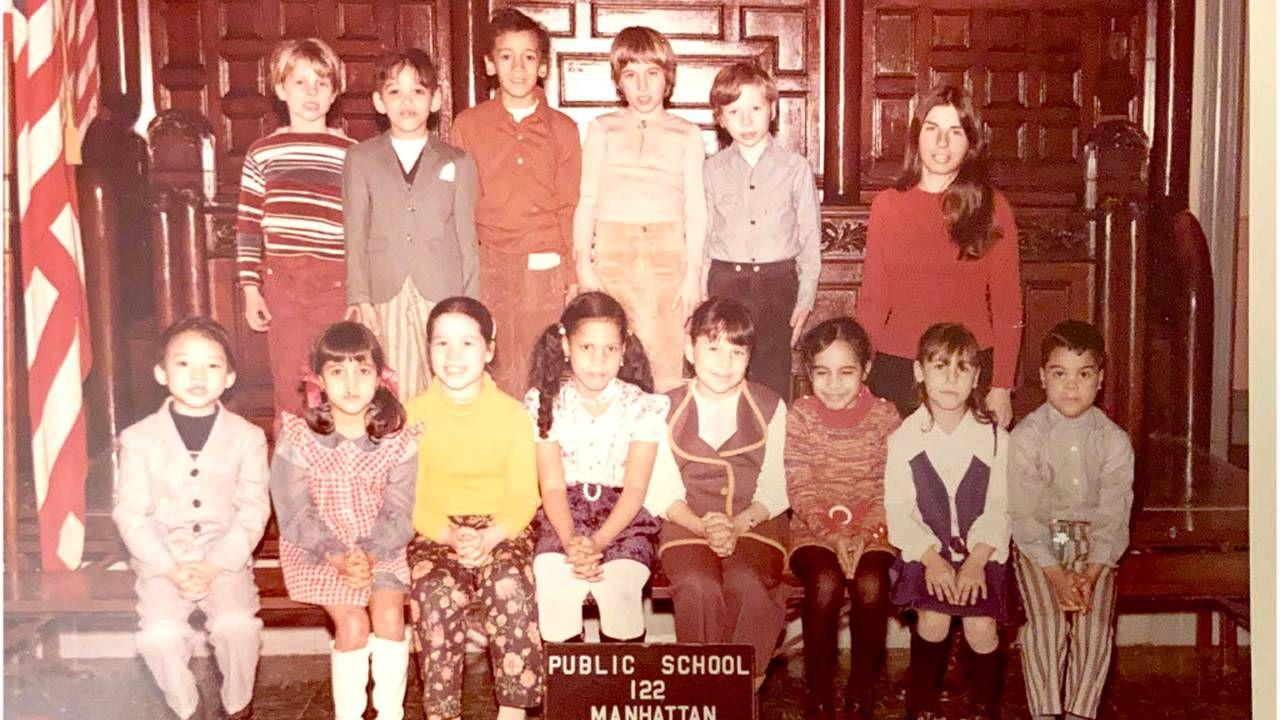 An old class photo teacher is standing to th right. Teacher, teaching, Next Avenue