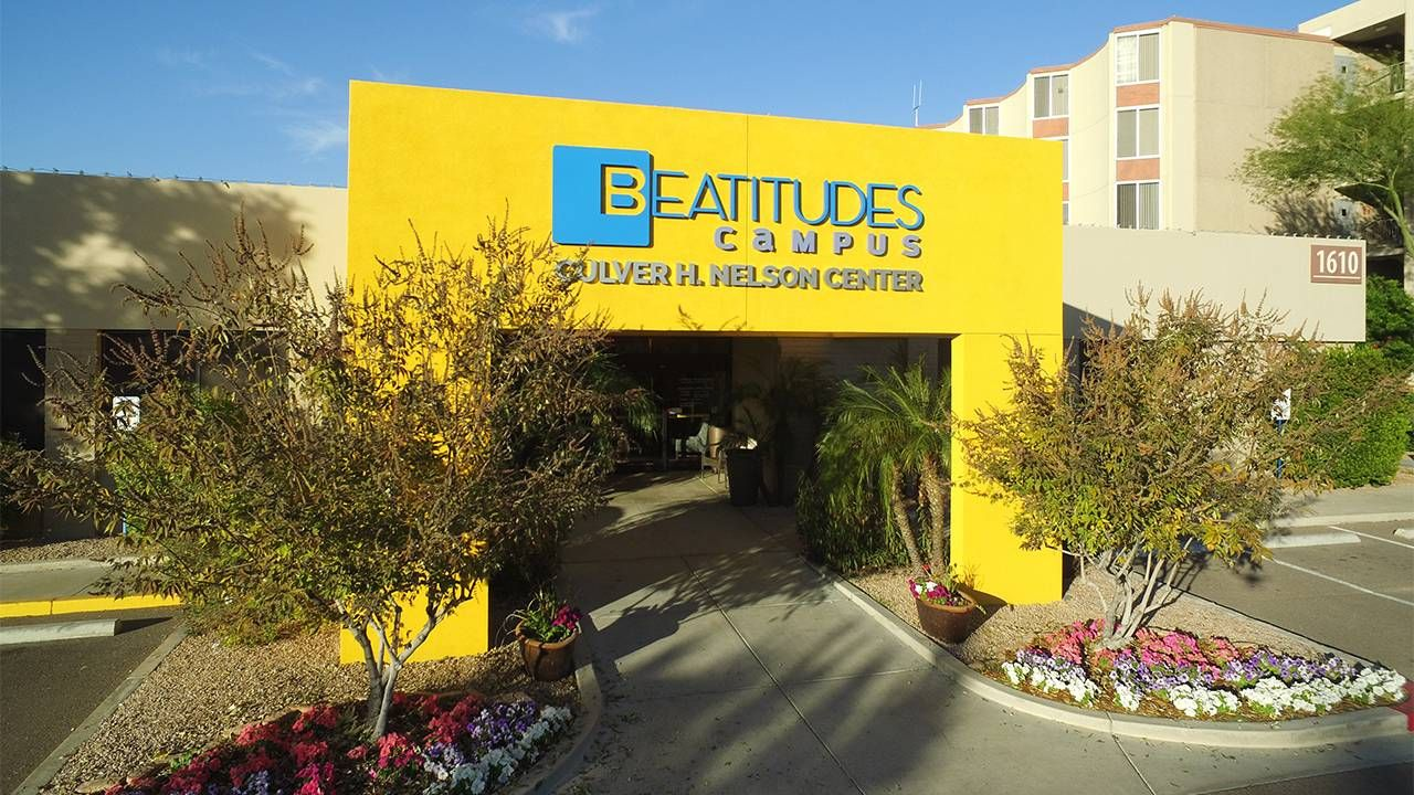 the outside lobby of the Beatitudes Campus building. Next Avenue, LGBTQ housing