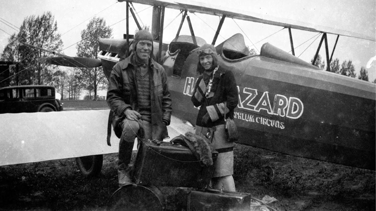 An old photo of the author's great-grandmother next to an old airplane. Next Avenue, circus