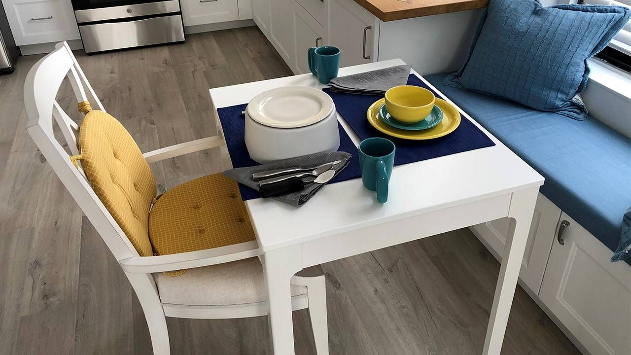 A dining table with elevated dishes. Dementia, Next Avenue, apartment