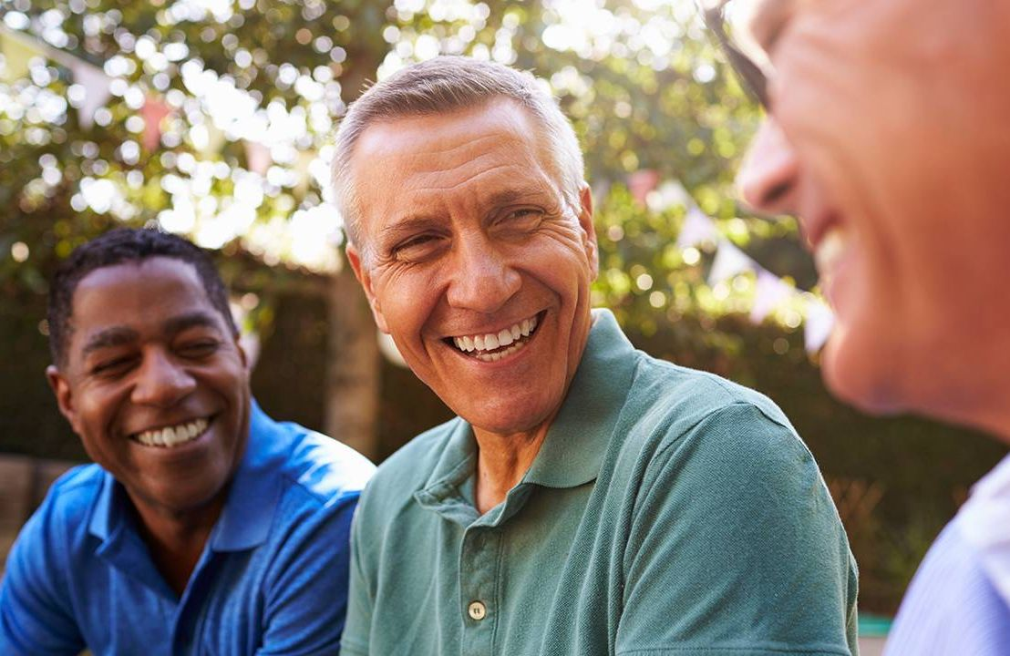 A group of male friends talking to each other. Next Avenue, conversations, friendship, health