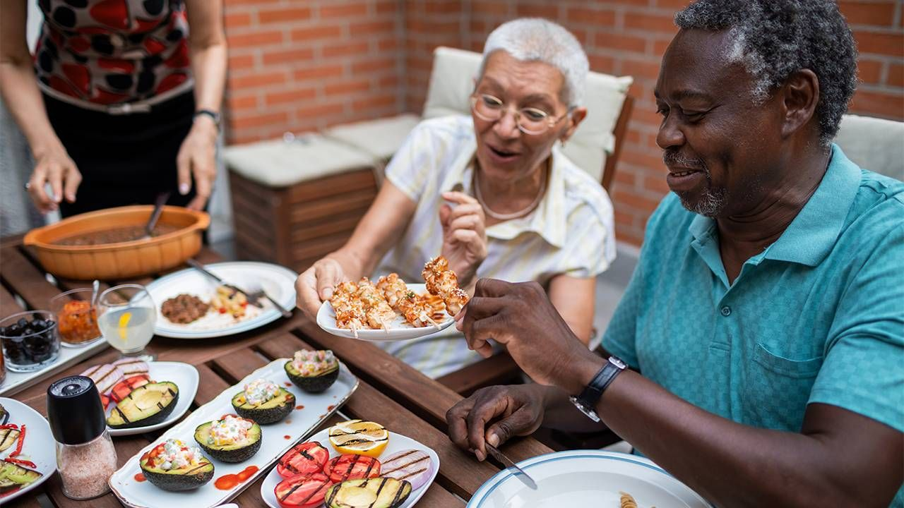 Older adults sharing a healthy barbecue. Next Avenue, BBQ, fourth of july