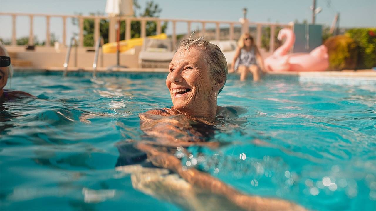 Fun, key to happiness, A woman swimming and laughing in a pool. Fun, happiness, Next Avenue