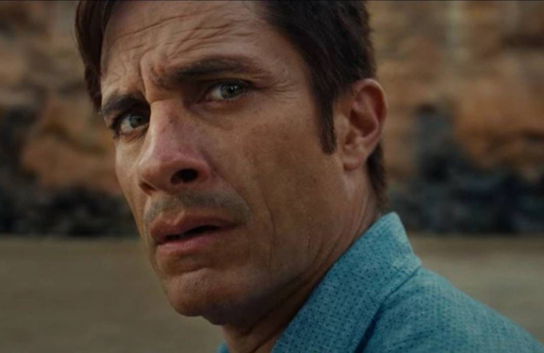 """A man looking scared, still from the """"Old"""" film trailer. Next Avenue, Old movie, M. Night Shyamalan"""