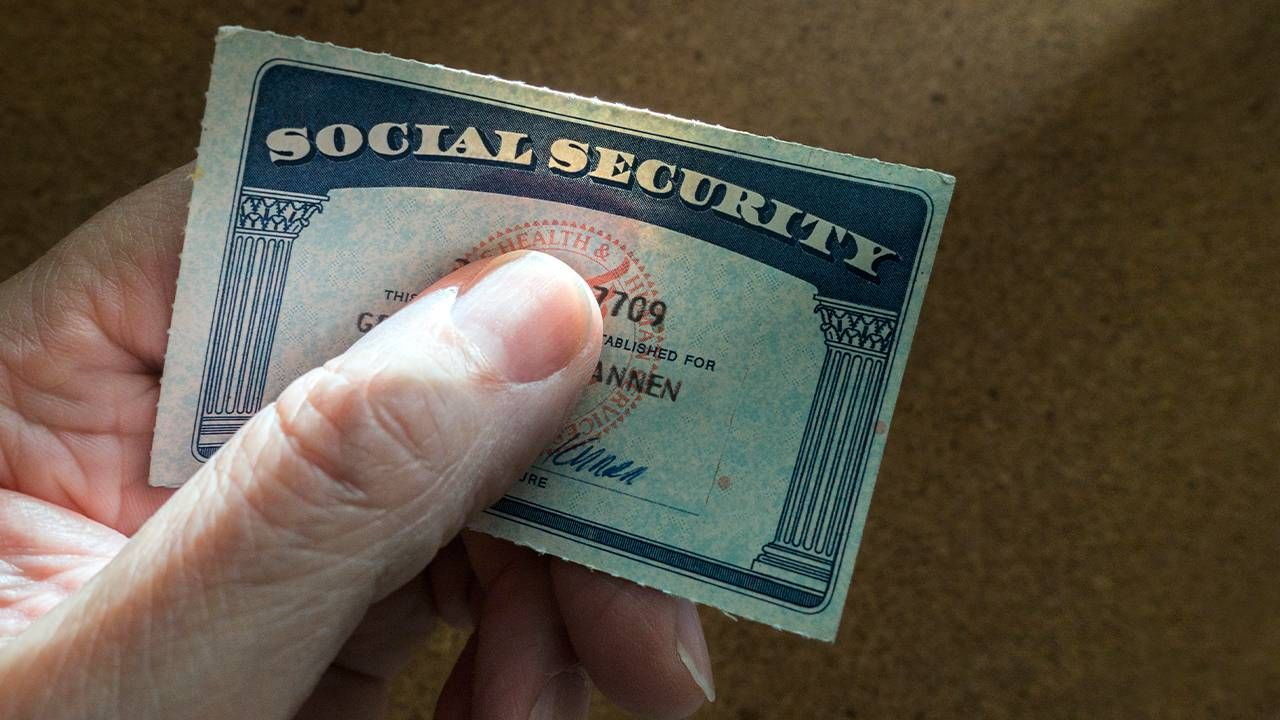 A person holding their social security card. Next Avenue, when to claim social security
