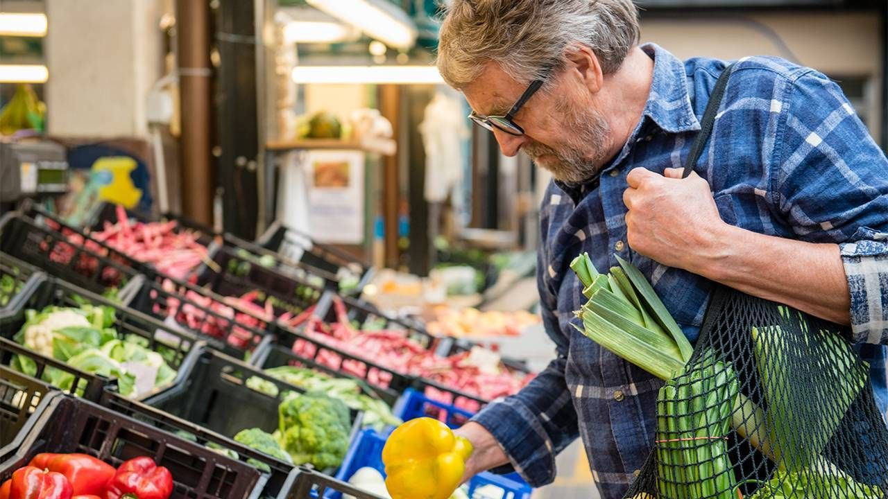 A man shopping at the grocery store. Next Avenue, solo aging