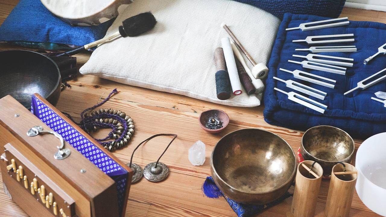 Pillows, brass bowls, quartz bowls, bamboo tubes, and bells. Sound bath, Next Avenue, stress