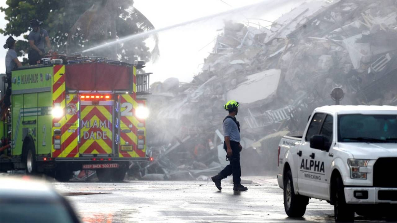 Clean up crews and firefighters at the Surfside condo building collapse. Next Avenue, building safety