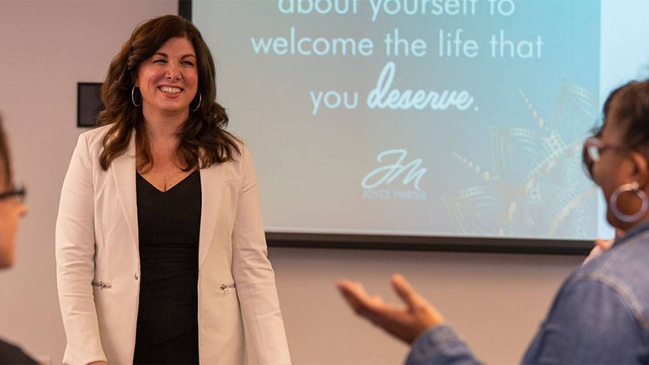 """Joyce Marter author of """"The Financial Mindset Fix"""" speaking at an event. Mental health, financial health, Next Avenue"""