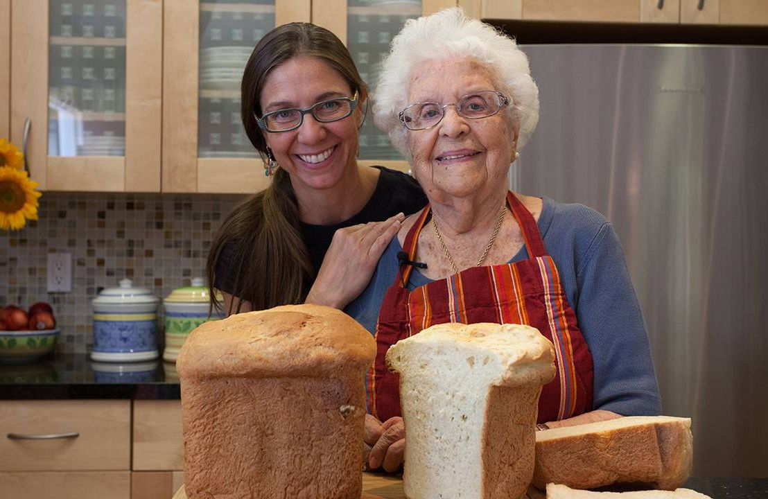 The filmmaker and her grandmother smiling in the kitchen. Next Avenue, Lives Well Lived Documentary