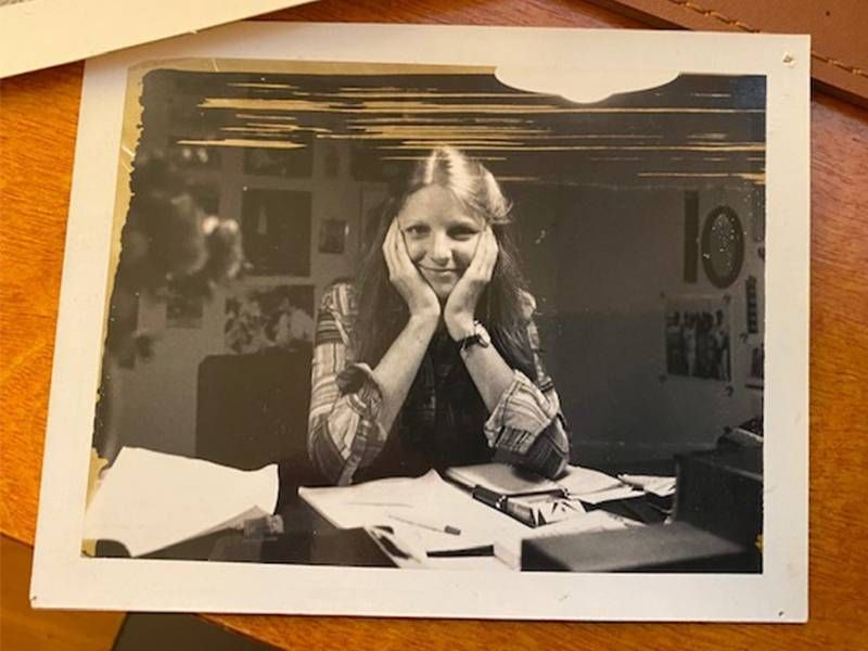 An old photo of Sandi Bachom smiling at a desk. Next Avenue, documentary filmmaker