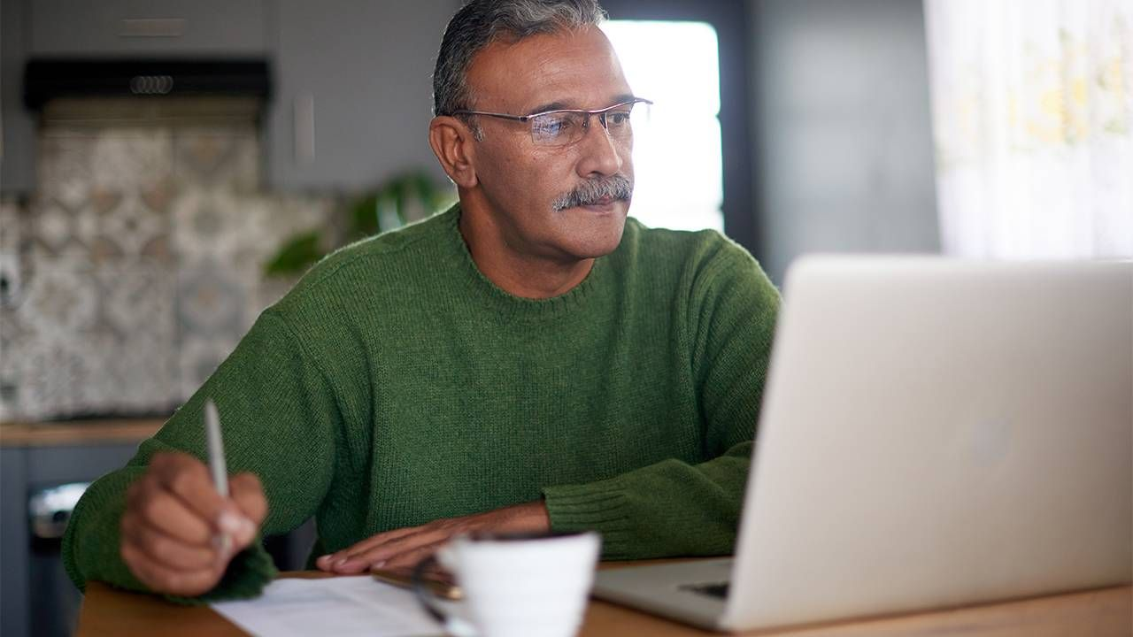 A man working in digital marketing on his computer. Next Avenue