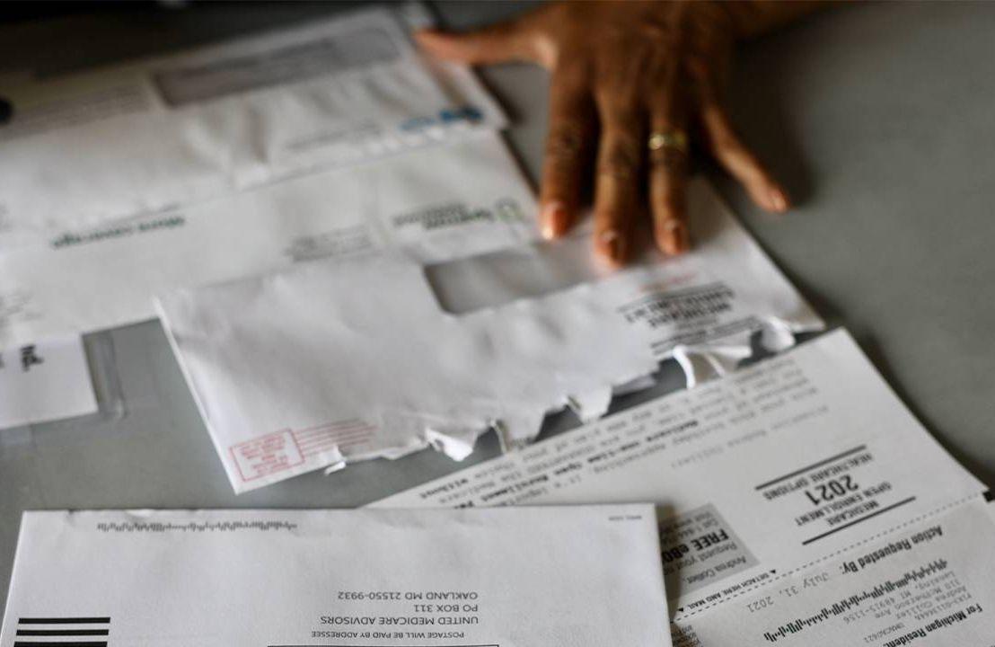 Andrea King Collier sorting through medicare paperwork. Next Avenue, finances, financial, money