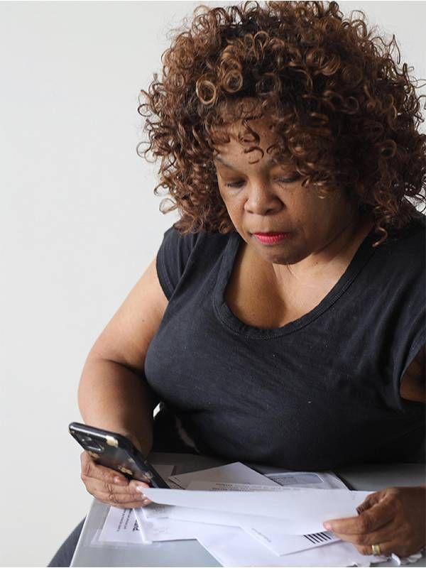 Andrea King Collier calculating her finances. Next Avenue, medicare, financial, money
