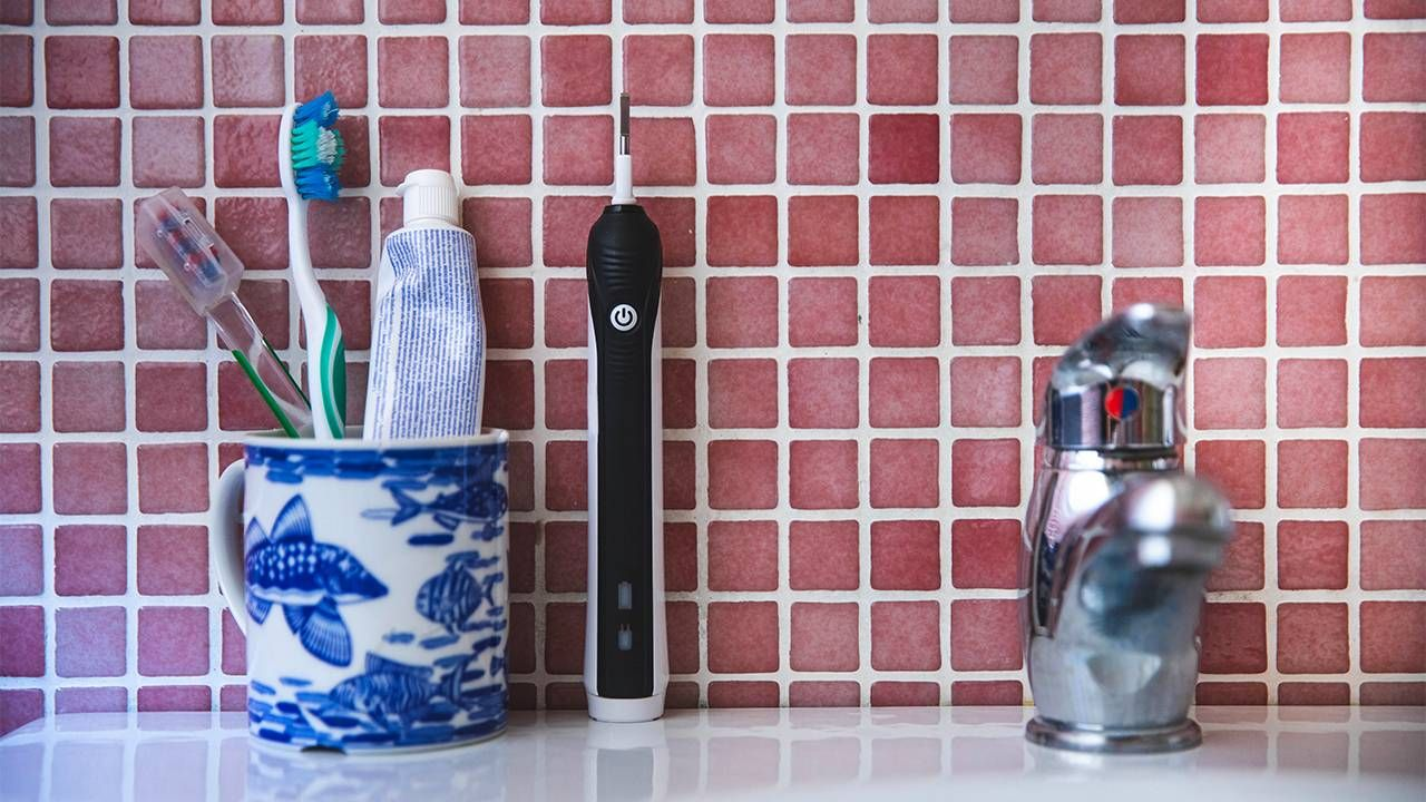 Toothbrushes in a holder. Next Avenue, hospital Acquired Pneumonia