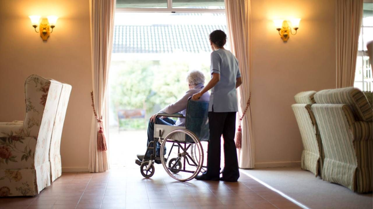 A long-term care resident and a long-term care staff person. Next Avenue, memory care, alzheimer's, dementia