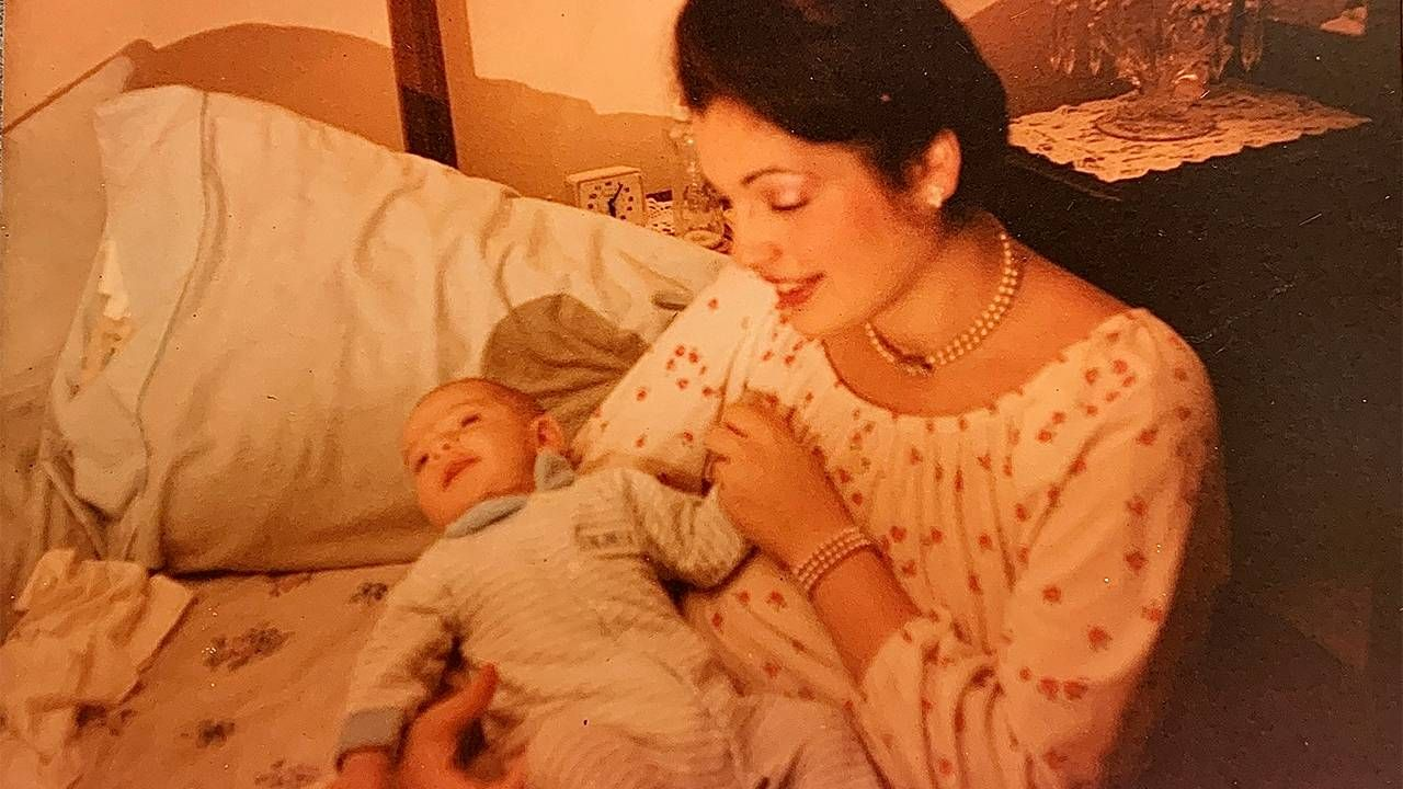 Old photo of the author as a baby being held by his mother. Next Avenue, malaria, mother