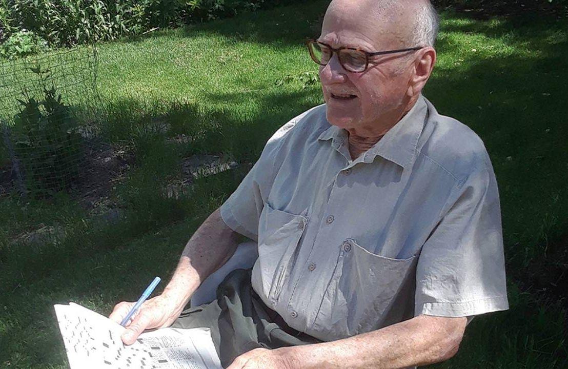 David Koulack sitting outside with a newspaper. Mild cognitive impairment, Next Avenue