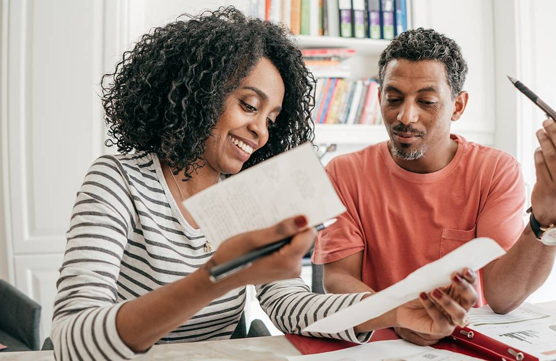 A couple working on finances at home. Next Avenue, retirement savings, gender split, pandemic