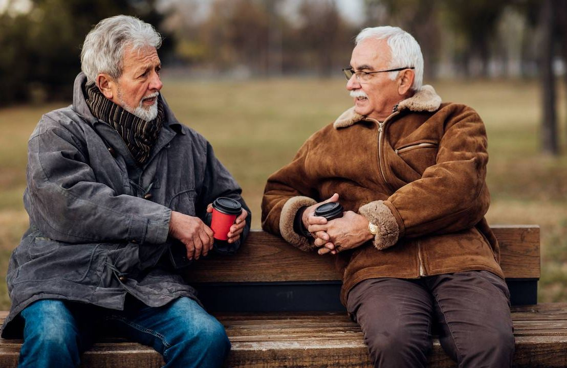Two men sitting on a bench.