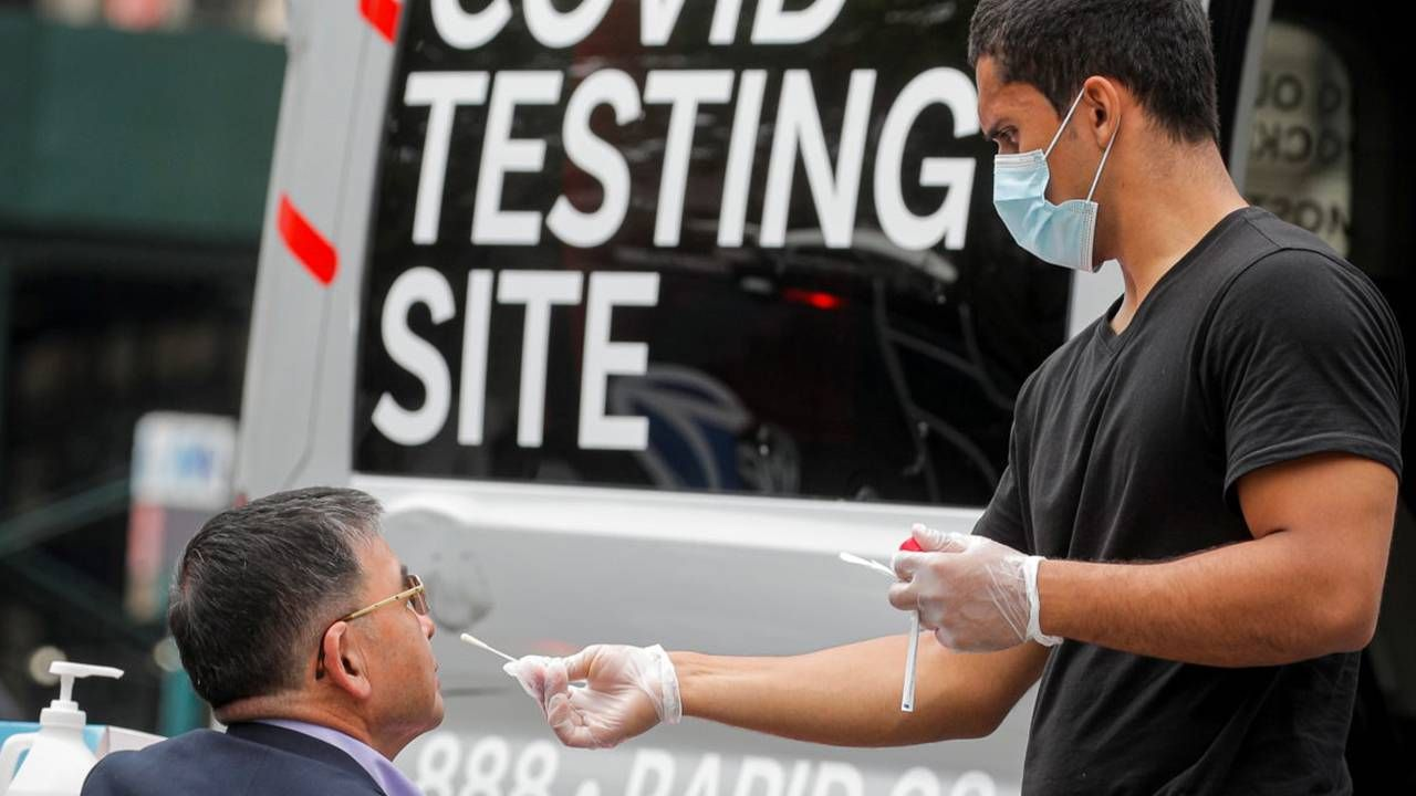 A patient getting a COVID-19 nasal swab test. Next Avenue, vaccinated, breakthrough infection
