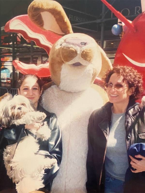 The author with her motherstanding with a mascot. Next Avenue, 9/11, september 11, middle school