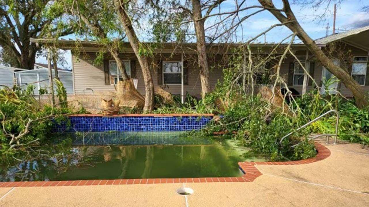 Lori Lyons backyard and pool with fallen tree limbs and debris. Next Avenue, hurricane Ida, new orleans
