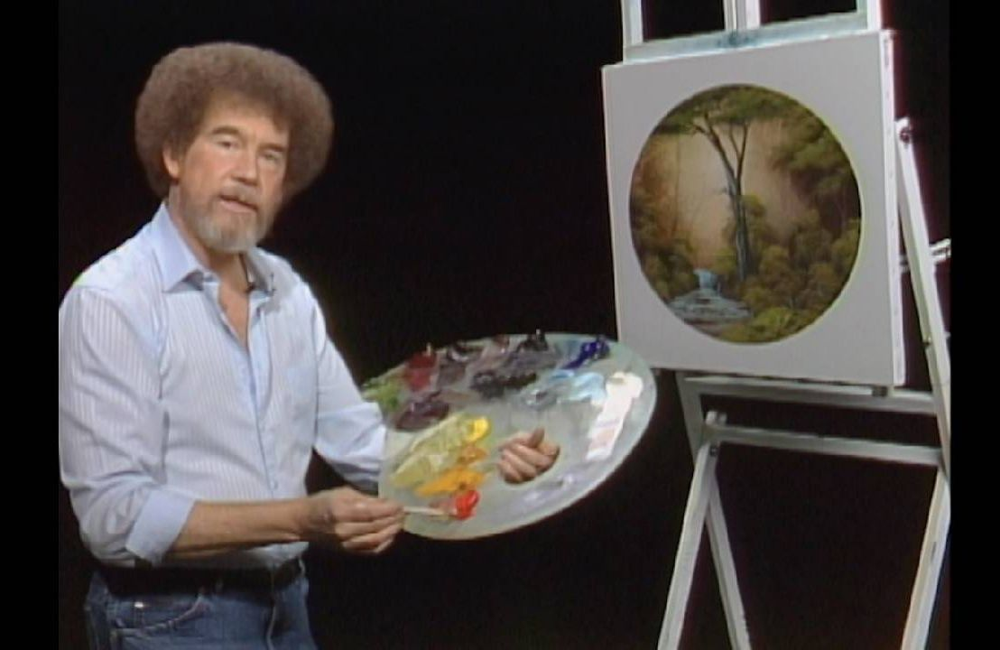 Bob Ross standing with a painter's palate and a painting. Next Avenue, Bob Ross estate, inheritance, business owners