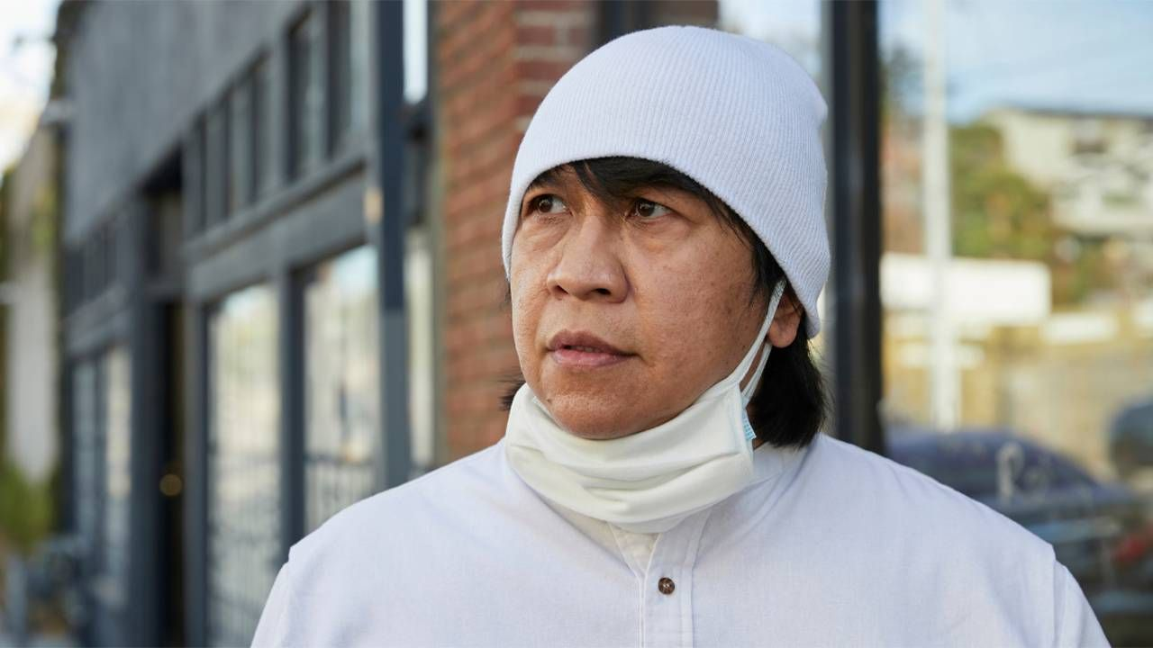 A man wearing a white hat and face mask. Next Avenue, paid caregivers, CNAs, caregiving