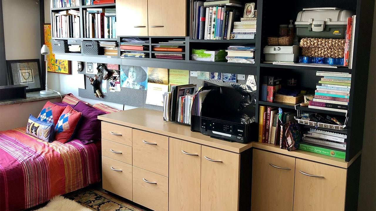 A well organized space with cabinets and a bed. Next Avenue, decluttering, declutter, feng shui, organizing