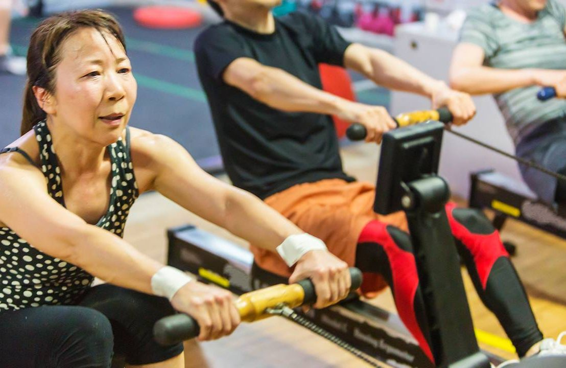 A group of people exercising on a rowing machine. Next Avenue, exercise, dementia, alzheimer's