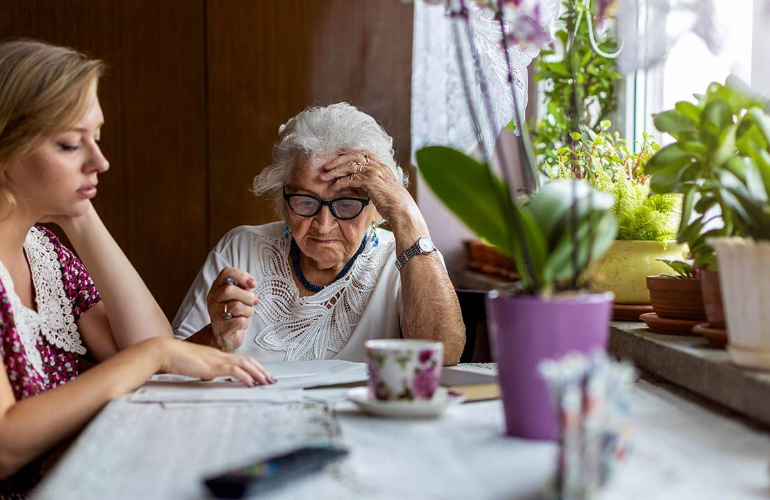 A family caregiver helping her mother with paperwork. Next Avenue, honesty,dementia care, Alzheimer's, tell the truth